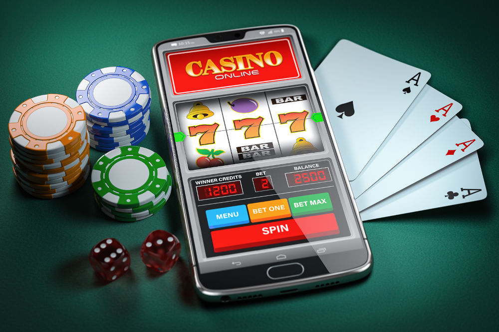 Slot machine on smartphone screen, cards, dice and poker chips.