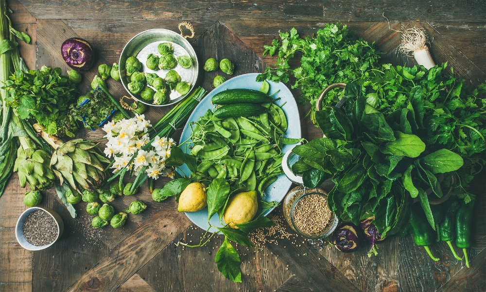 Vegetables and herbs on table