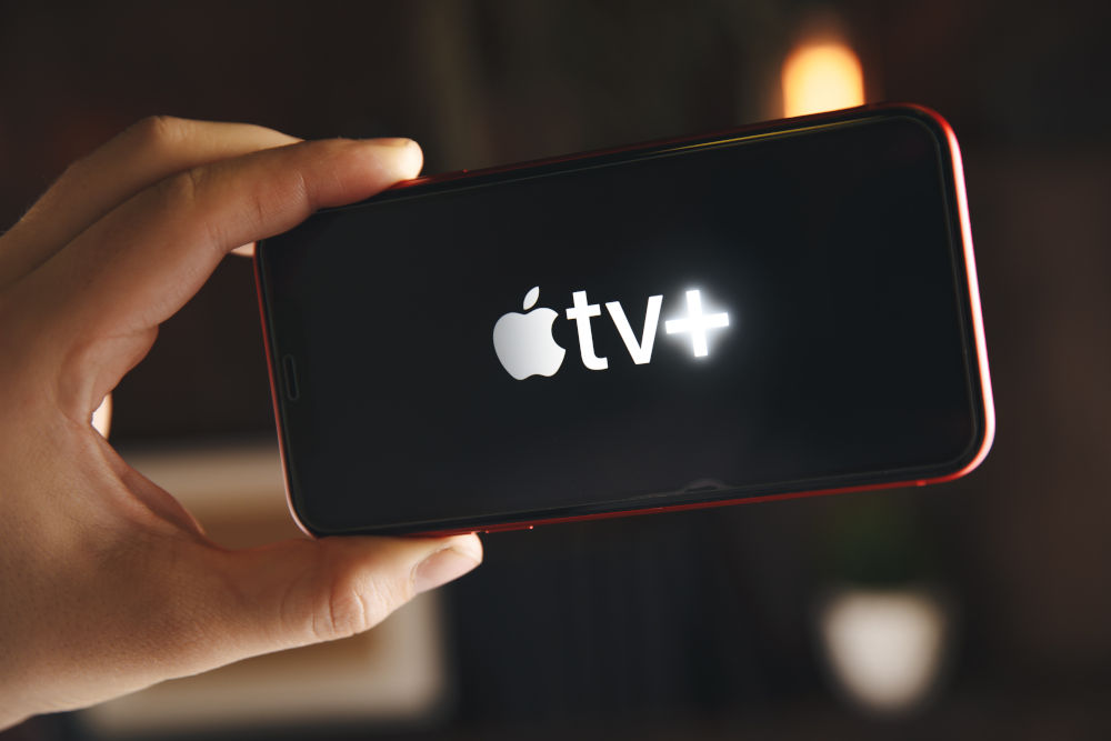 Apple TV shown on a phone being held