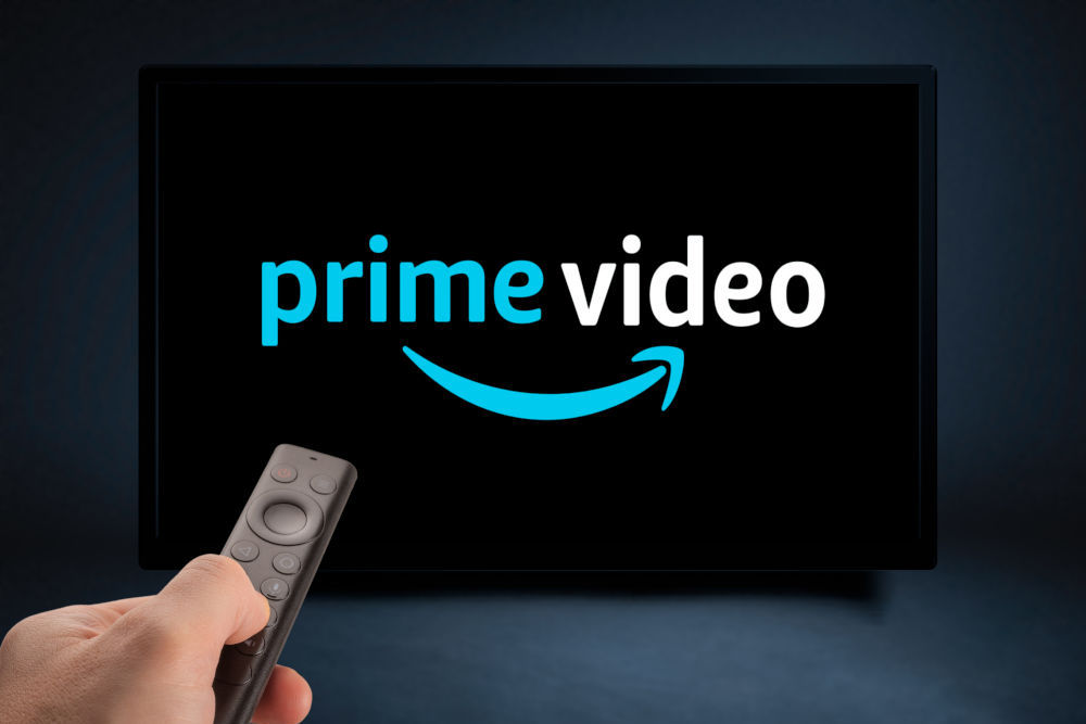 TV Remote in Hand and TV Screen with Amazon Prime Video Logo