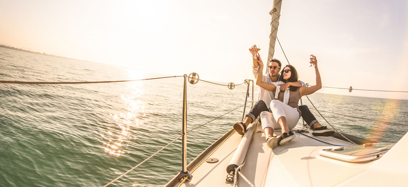 bigstock-Young-Lovers-Couple-On-Sail-Bo-279369679