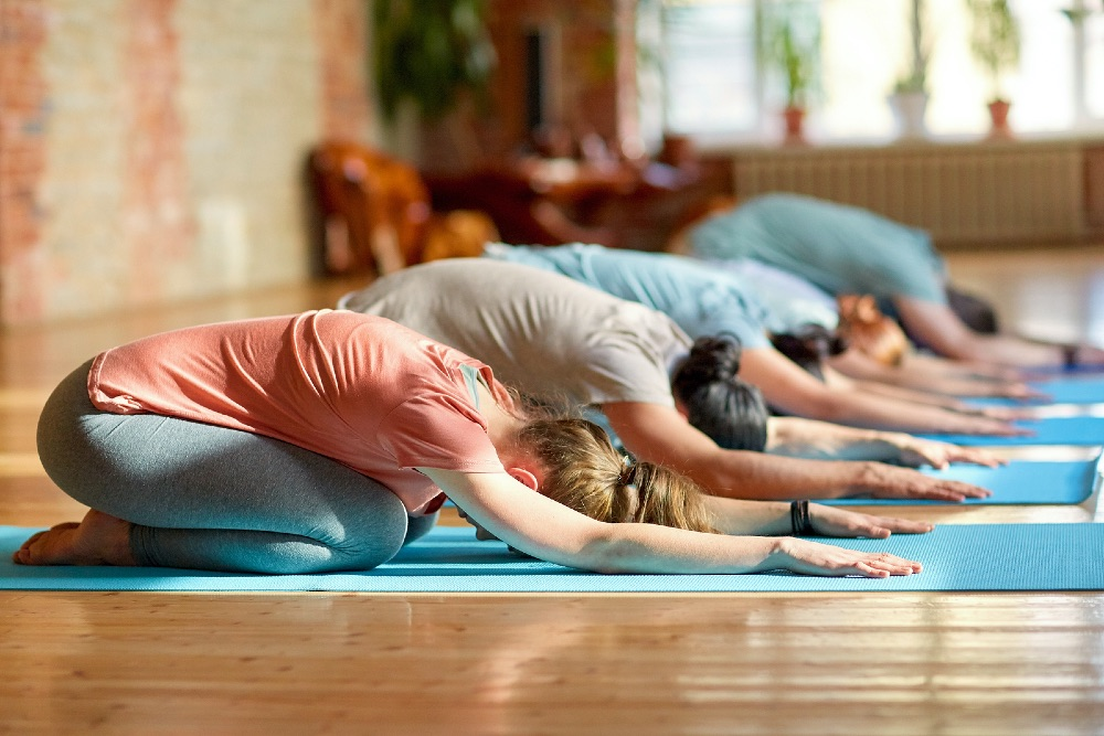 People practicing yoga in a class