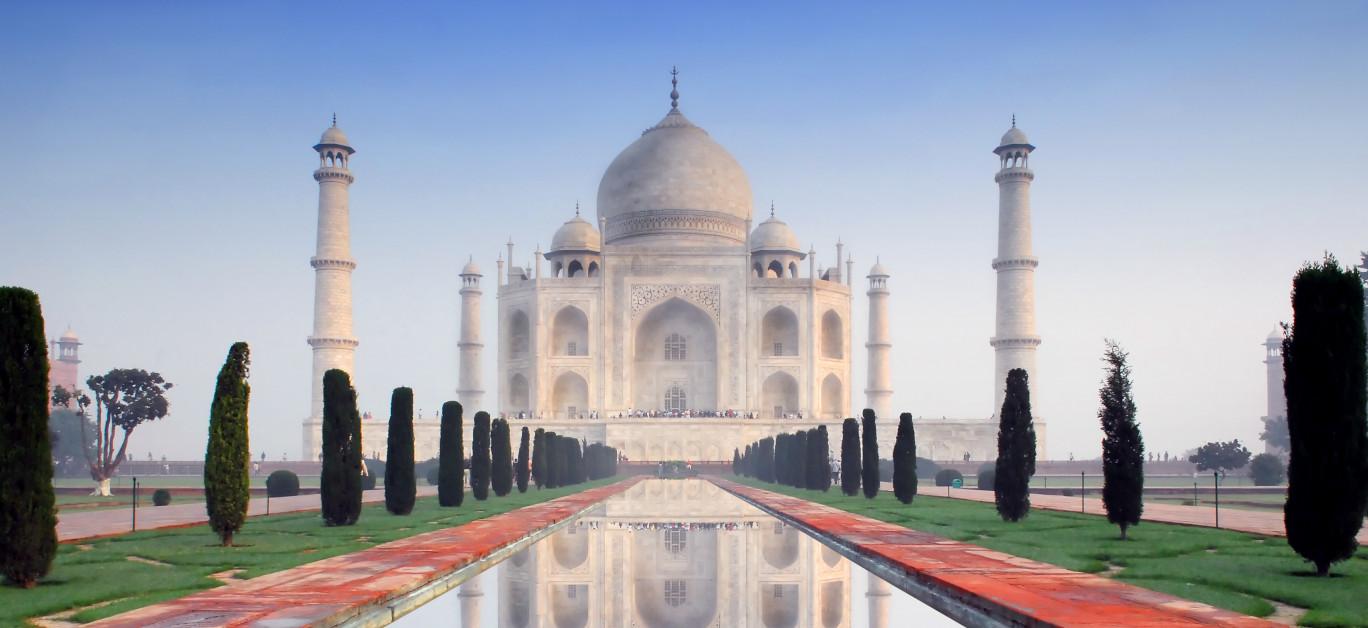 Taj Mahal in soft early morning light with blue sky