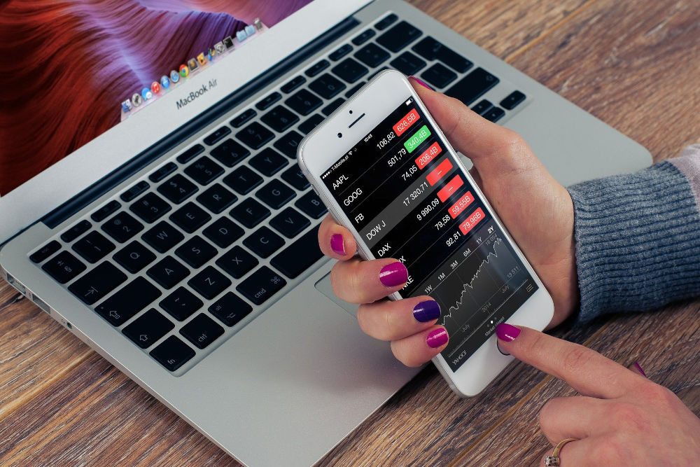 Woman checking stocks on her phone