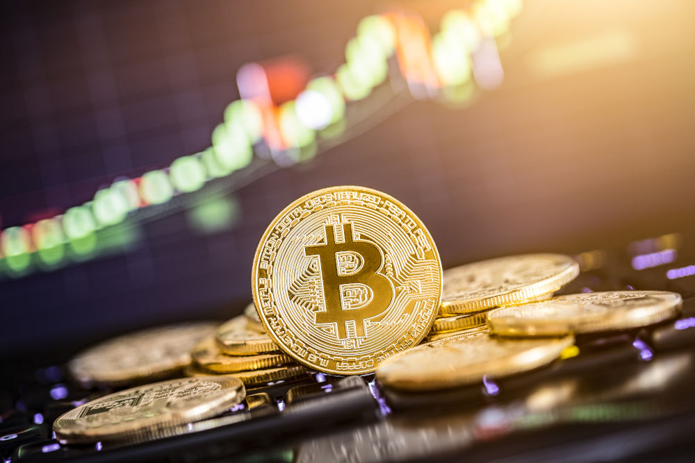 Bitcoin gold coin and defocused chart background