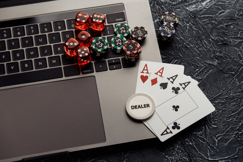 Chips, dices and playing cards with aces for poker online or casino gambling