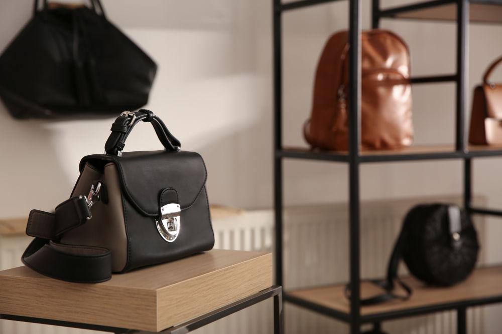 Elegant black bag on table in luxury boutique