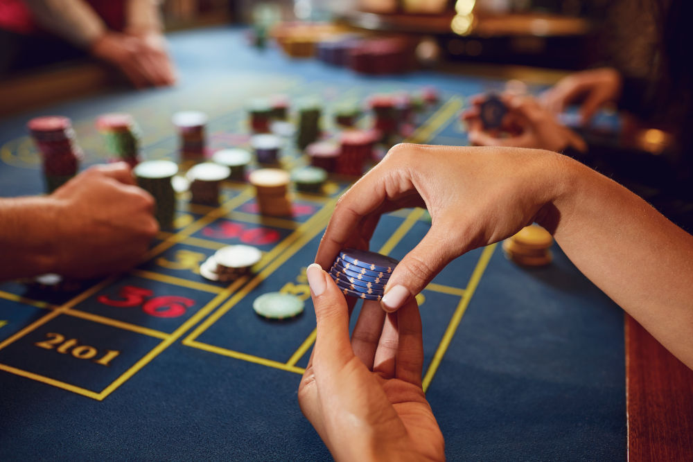 Gamer play casino roulette at a table in a casino