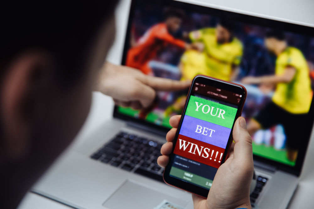 Man celebrating victory on an online bet