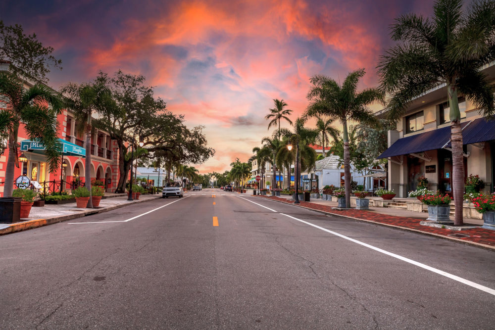 Sunrise over the Third Street shopping district in Old Naples, Florida
