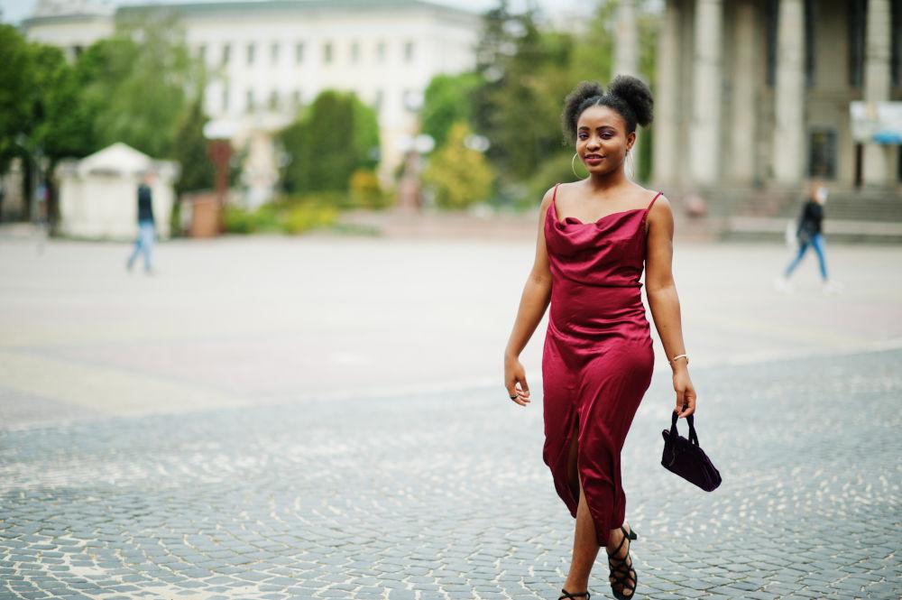 model in red silk dress