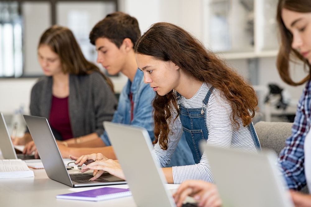 College students studying on laptop