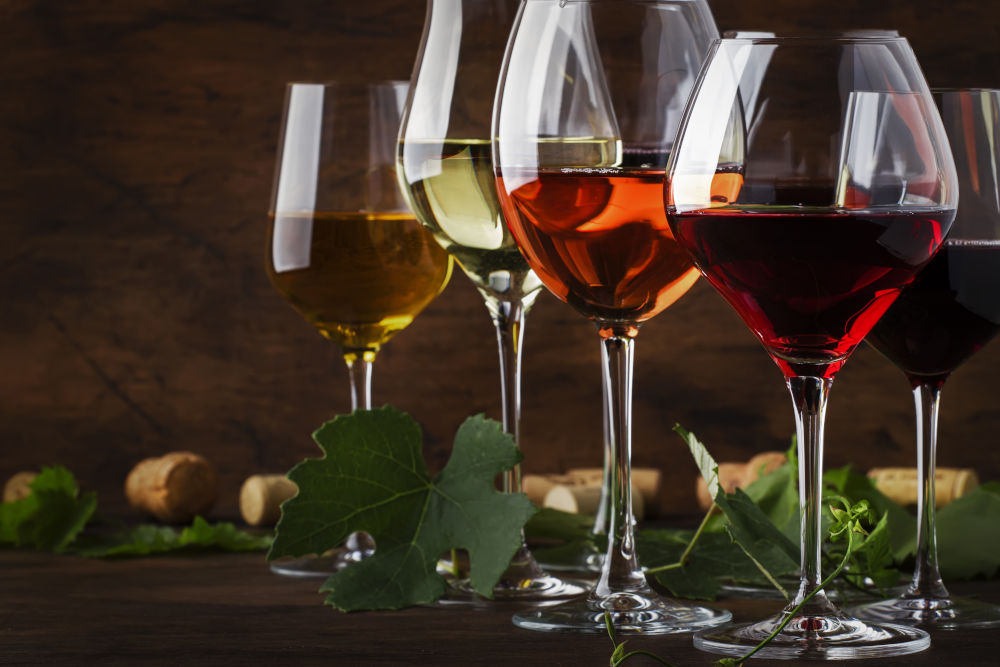 Red, white and rose wine in assortment in wineglasses
