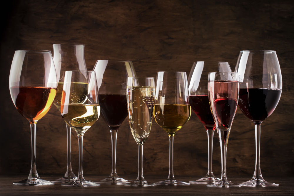Red, white wine, rose and champagne in wine glasses