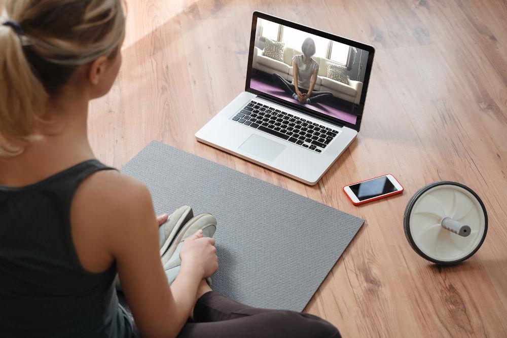 Yoga teacher conducting virtual class at home