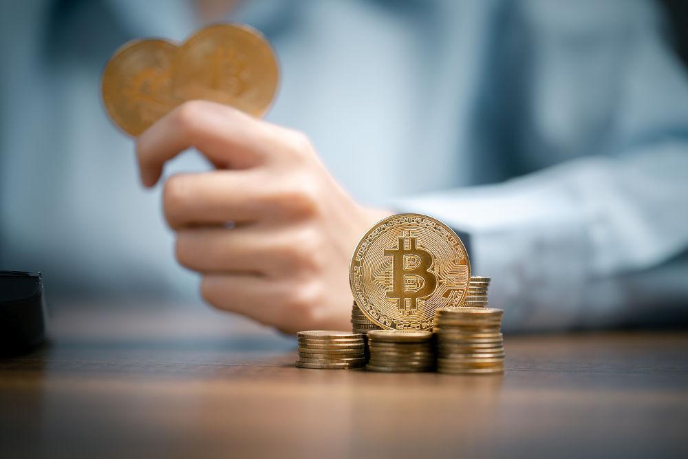 Bitcoins, Bitcoin in hand of woman,