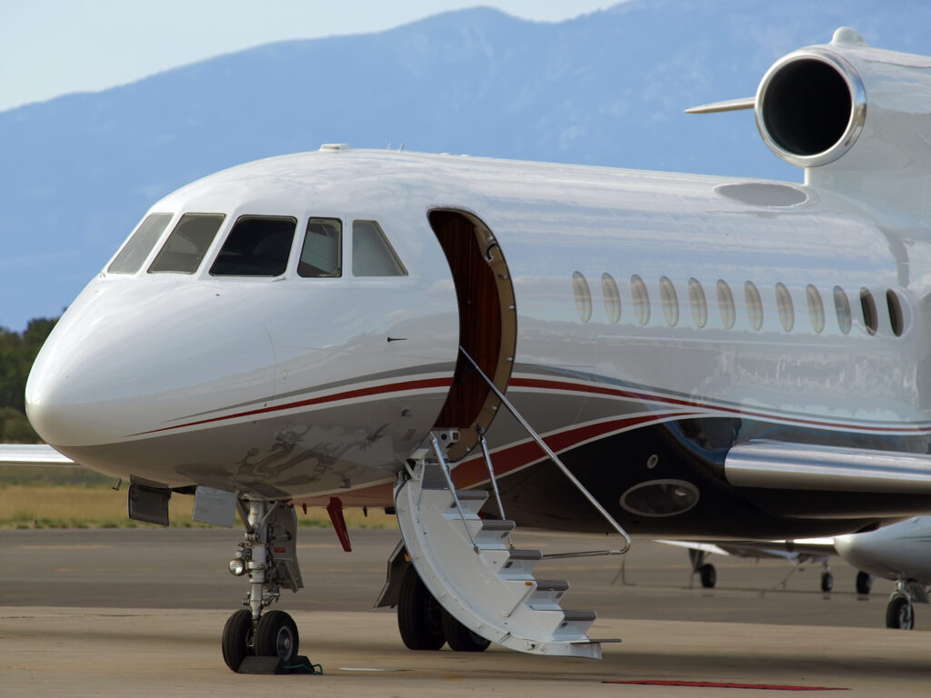Business jet with stairway down for loading unloading passengers