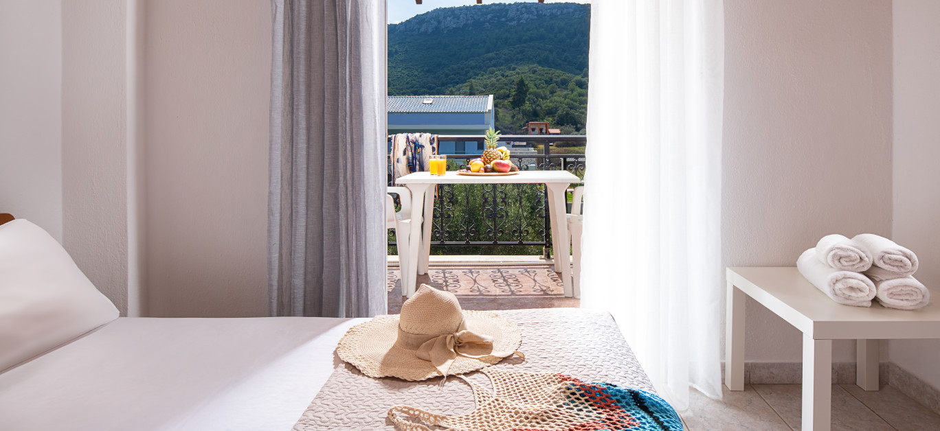 Closeup Of Open Door To Summer View Balcony With Terrace Furniture