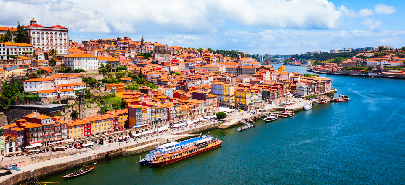 Douro River And Local Houses With Orange Roofs In Porto City Aer