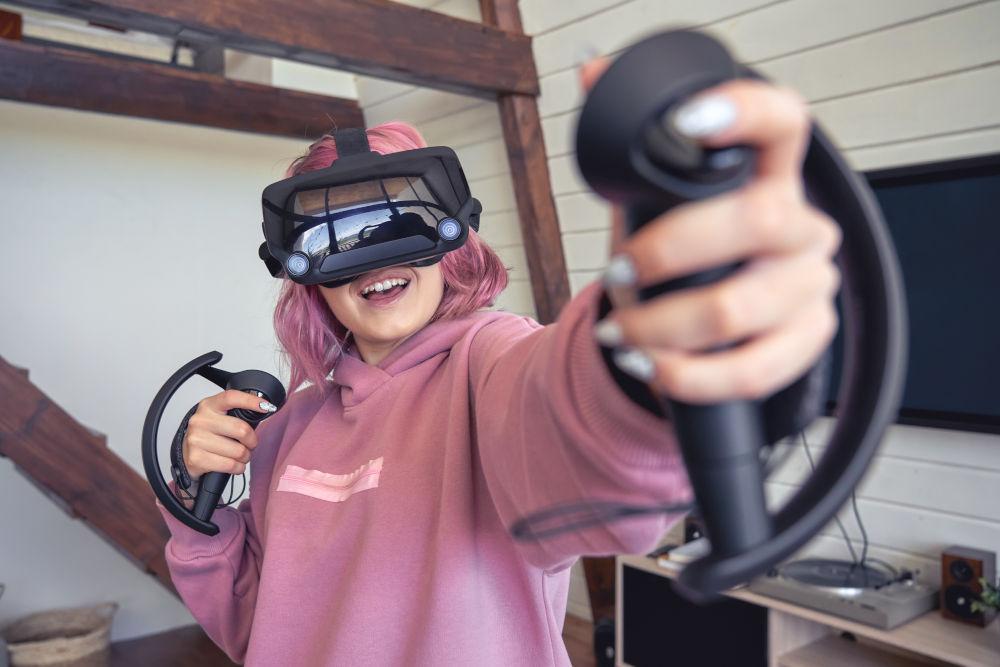 girl playing virtual reality video game