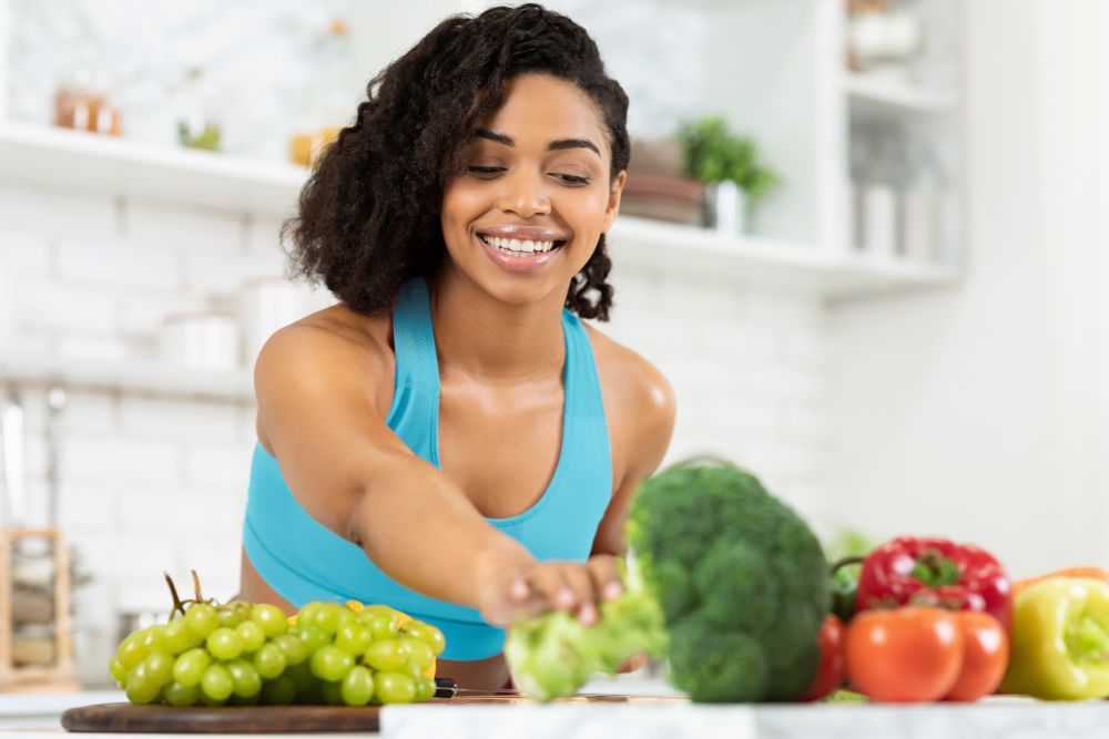 lady cooking dinner with fresh organic vegetables to improve health and immune system