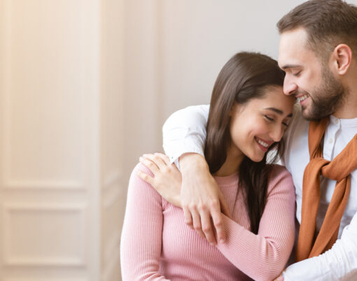Love And Affection. Young Couple In Love Hugging Standing Near