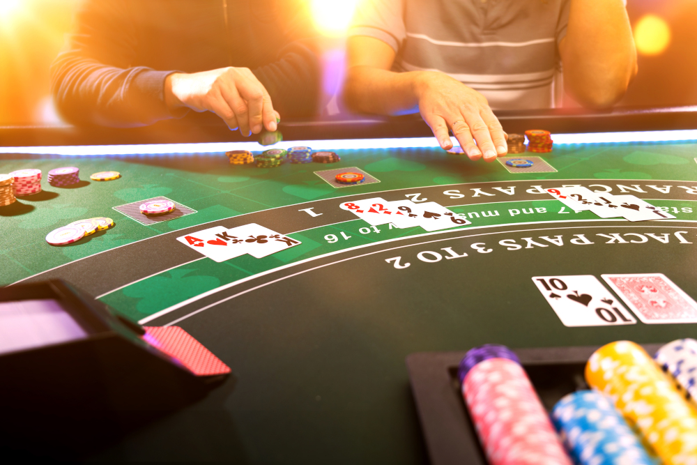 Men playing BlackJack at the casino table