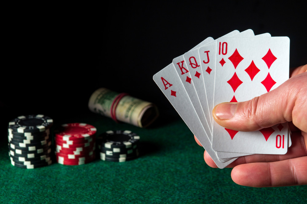 Poker cards with royal flush combination in the game