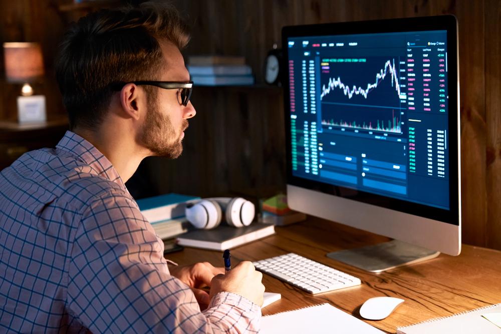 man trader analyst looking at computer monitor, investor broker analyzing