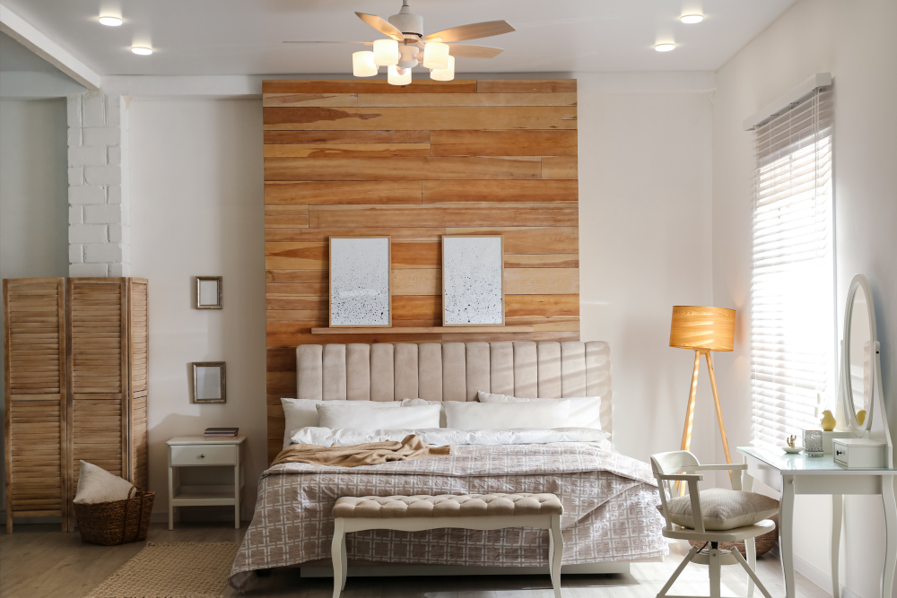 Stylish bedroom interior with modern ceiling fan and comfortable bench