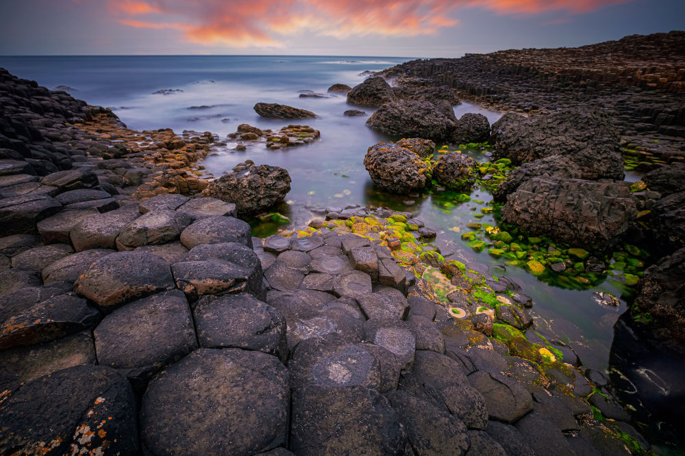 sunset over basalt rocks formation Giant's Causeway