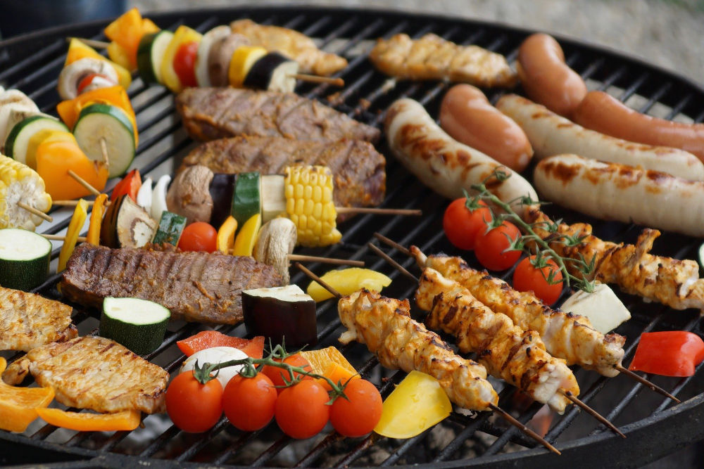 vegetables and meats on a barbecue