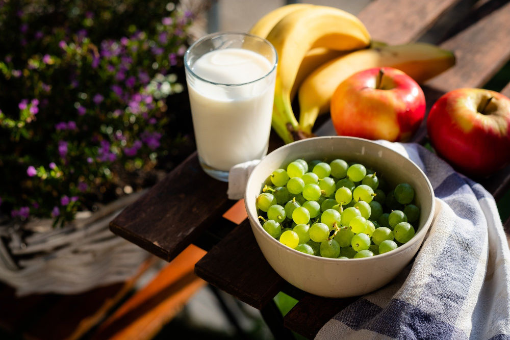 Fruits and glass of milk