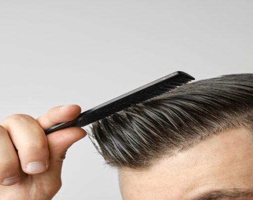 Close Up Young Man Combing His Hair