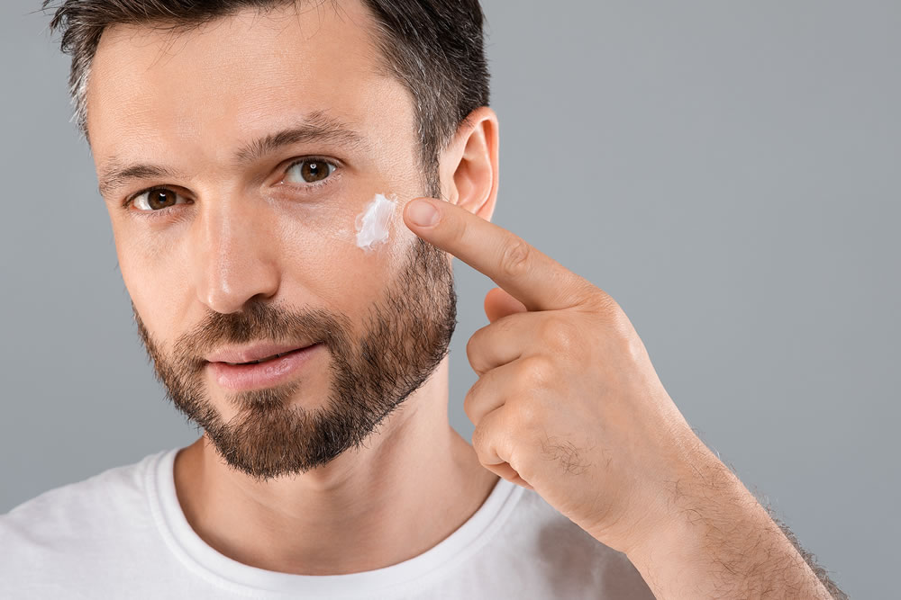man moisturising