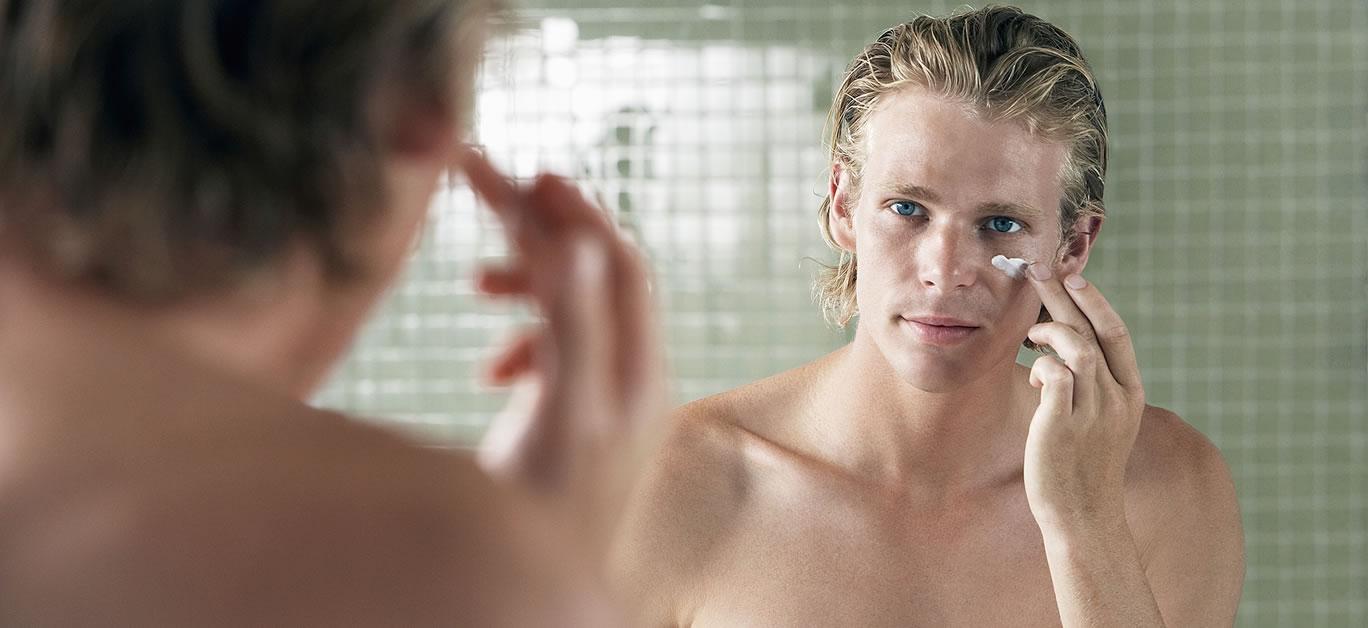 bigstock-Man-applying-facial-cream-in-f-7309985