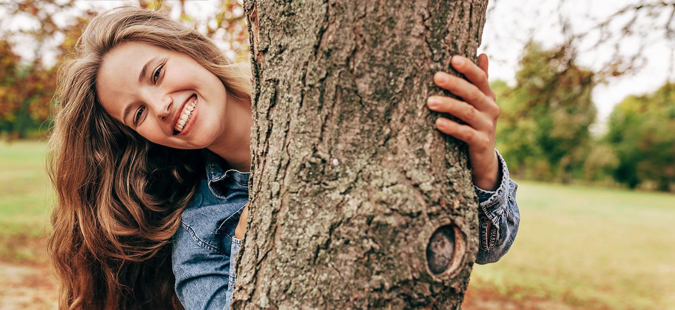 woman hugging tree