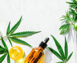 Various Glass Bottles With Cbd Oil, Thc Tincture And Hemp Leaves