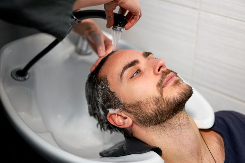 Man wash hair in beauty salon