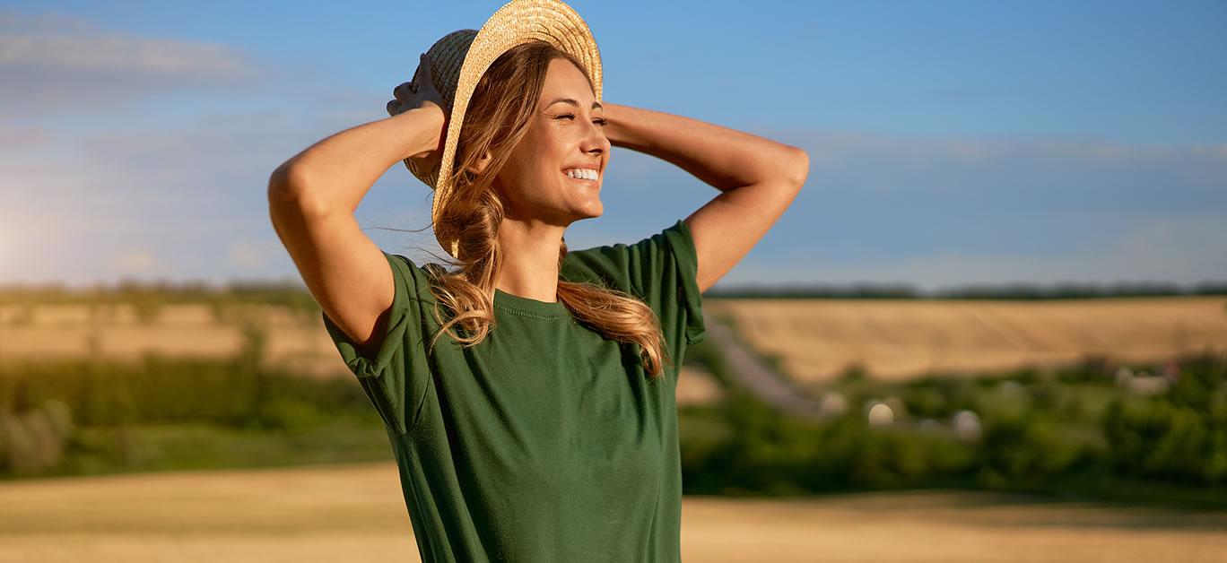 bigstock-Woman-Farmer-Straw-Hat-Standin-411568030