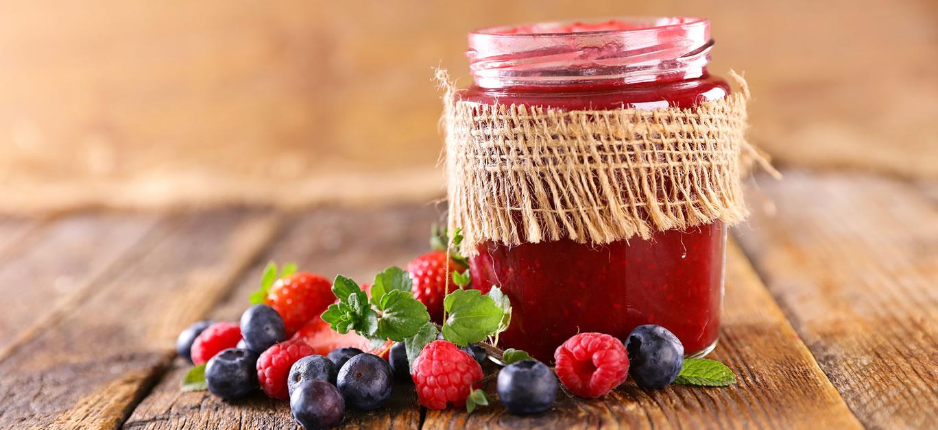 bigstock-berry-fruit-jam-on-wood-backgr-427301369
