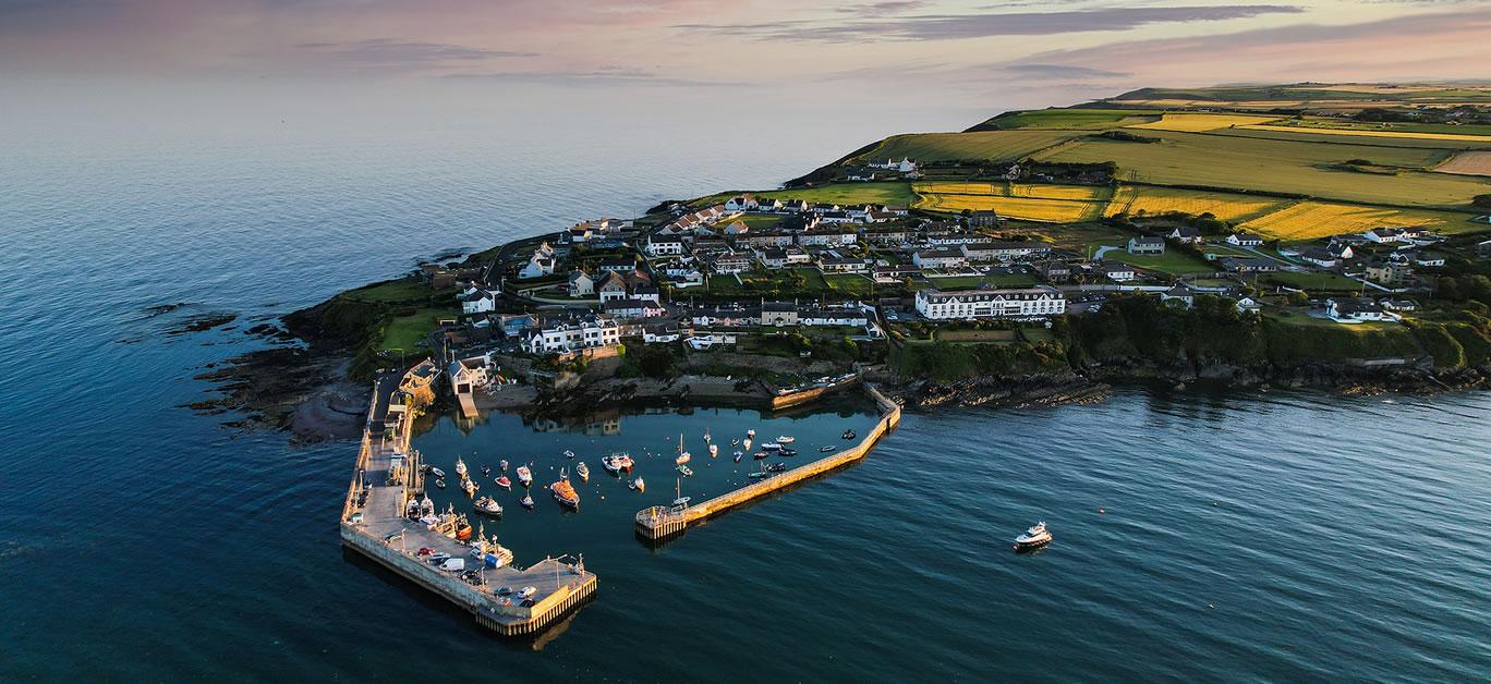 Aerial view of Ballycotton pier, a coastal fishing village in County Cork, Ireland
