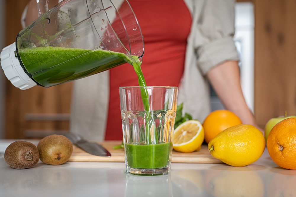 Woman pouring fresh juice in glass
