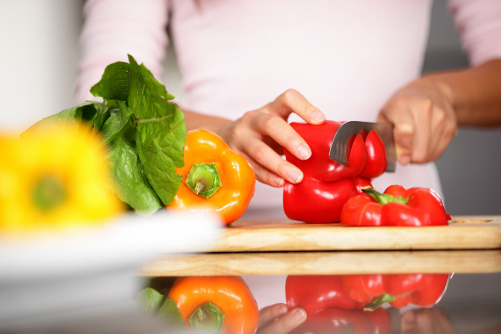Woman cutting red pepper