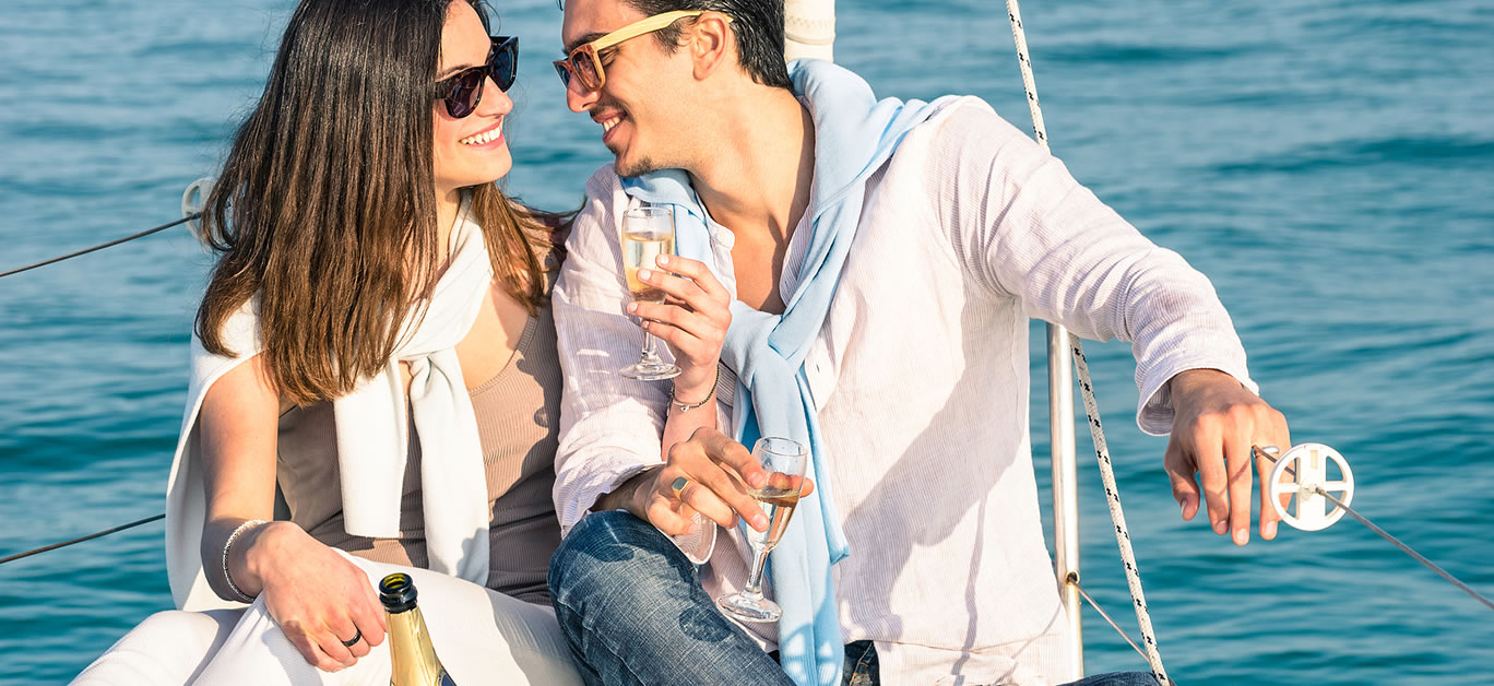 couple on boat drinking champagne