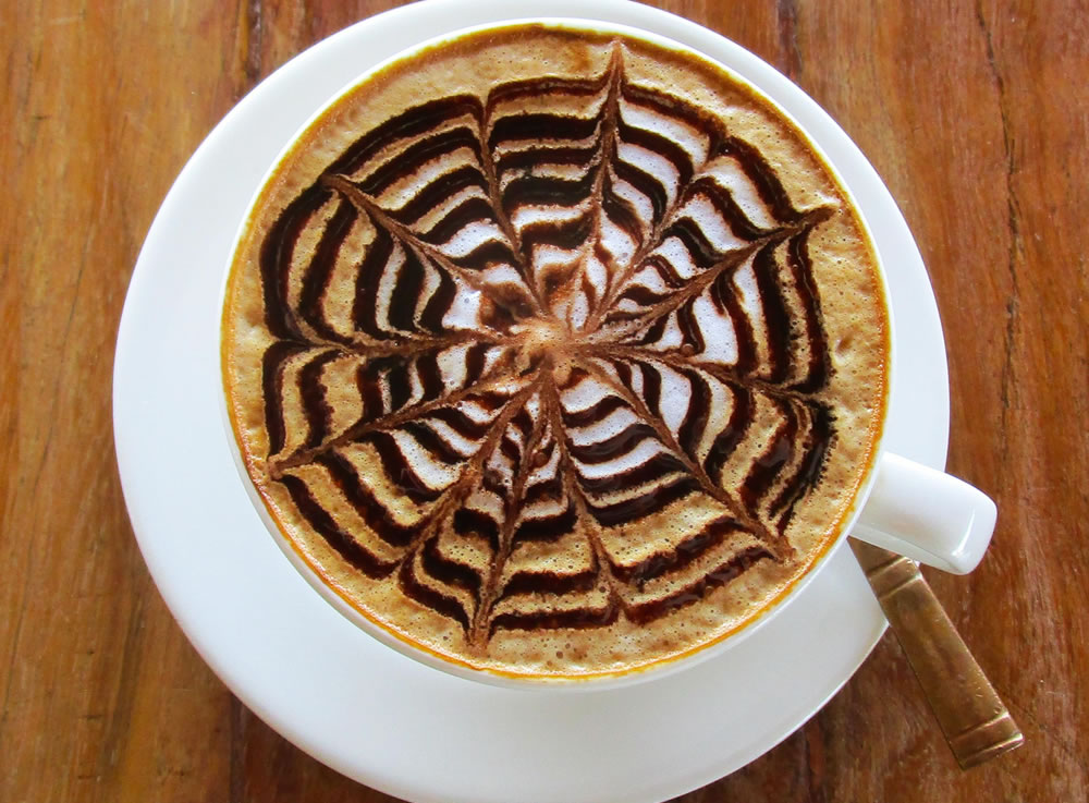 THE WORLD'S FAVORITE COFFEE-CAPPUCCINO WITH FANCY FROTHY DESIGNS
