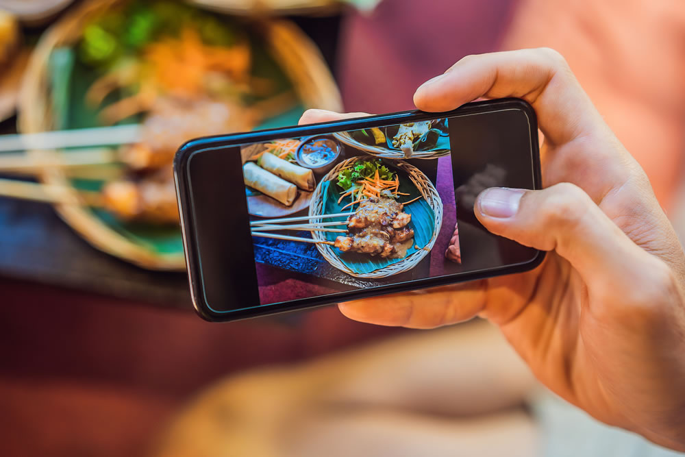 taking a picture of food on a mobile phone