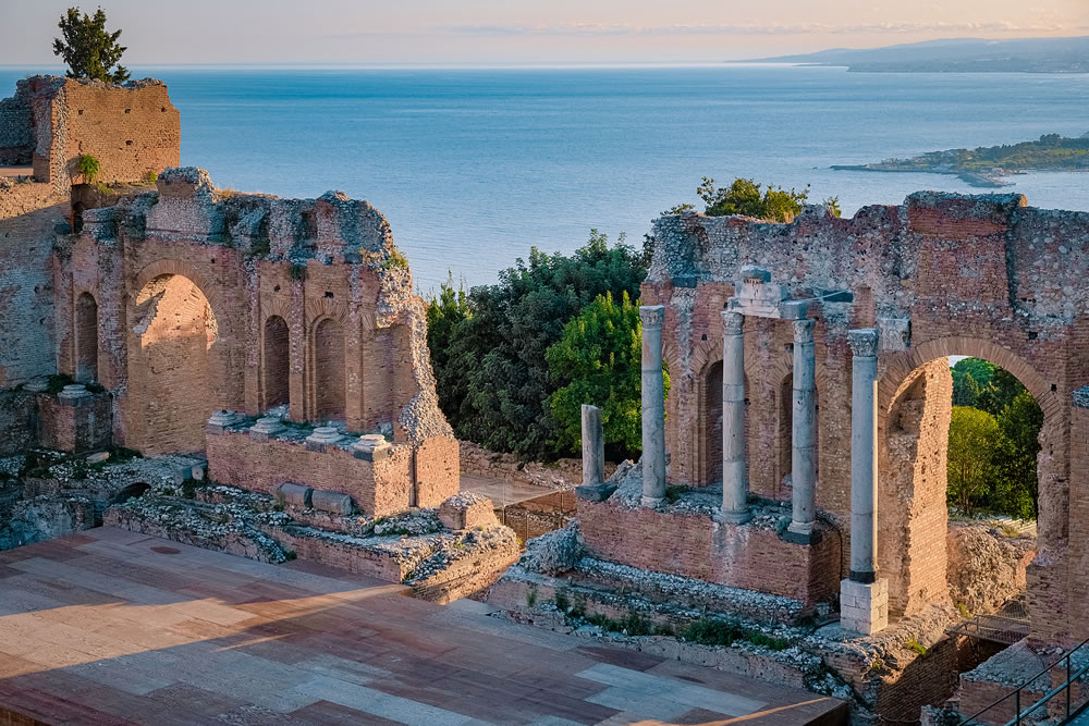 Taormina Sicily, sunset at the Ruins of the Ancient Greek Theater in Taormina, Sicily Italy