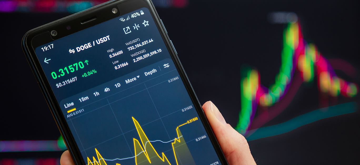 Trading pair DOGE USDT at Binance mobile app running at smartphone screen with a trading page at background