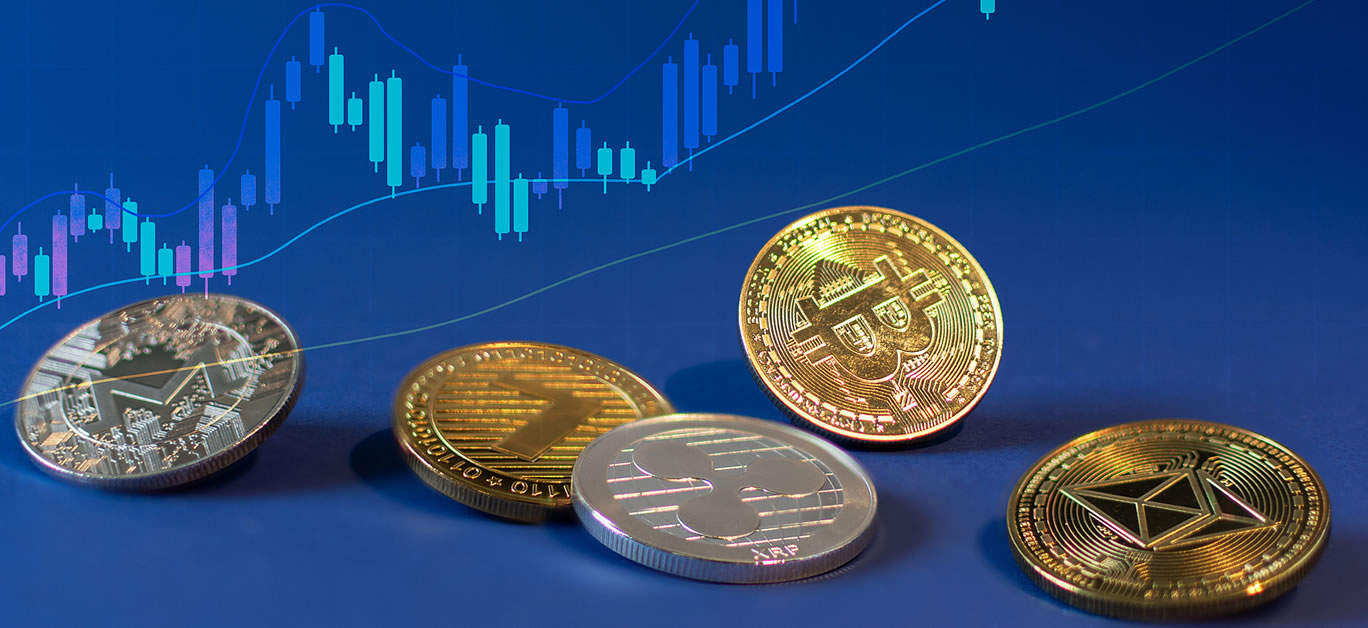 Various cryptocurrency coins with bitcoin in the centre on blue background
